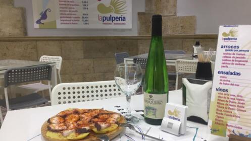 Ración de pulpo + botella de vino